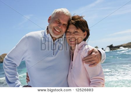 Portrait of happy senior couple at the beach