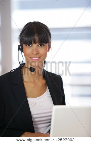 Portrait of smiling business woman with headset