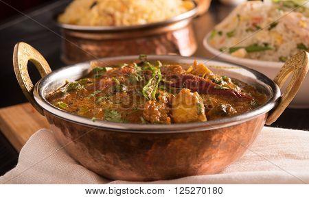 Paneer Butter Masala in a brass bowl