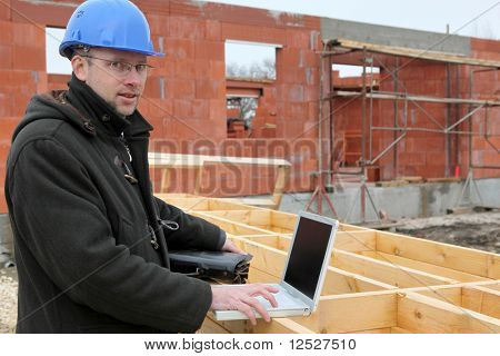 Portrait of a man wearing a safety helmet on a construction site
