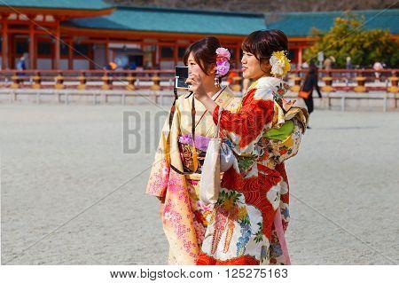 JAPAN - NOVEMBER 22 2015: Beautiful Japanese ladies in traditional kimono dress at Heian-jingu shrine kyoto