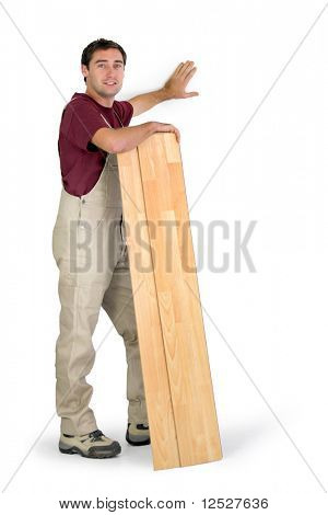 Smiling parquet layer on holding a board on a white background