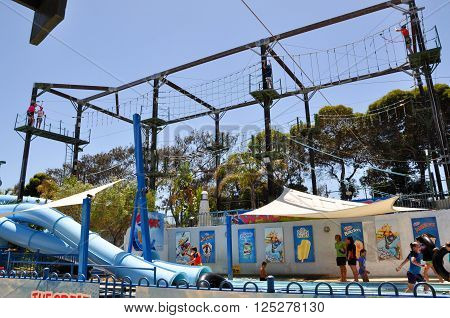 HILLARYS,WA,AUSTRALIA-JANUARY 22,2016: The Great Escape amusement playground with ropes course, zip lining, water slides and families at Hillarys Boat Harbour in Hillarys, Western Australia.