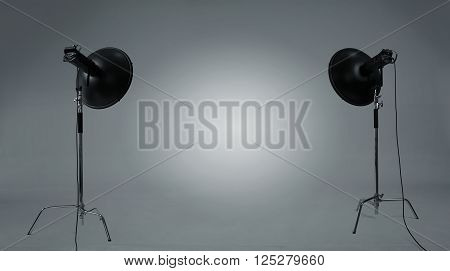 Empty photographic studio with gray backdrop and copy space