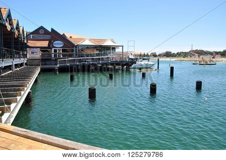 HILLARYS,WA,AUSTRALIA-JANUARY 22,2016: Cove with shops, restaurants, ocean pilings and a marina at Hillarys Boat Harbour in Hillarys, Western Australia.