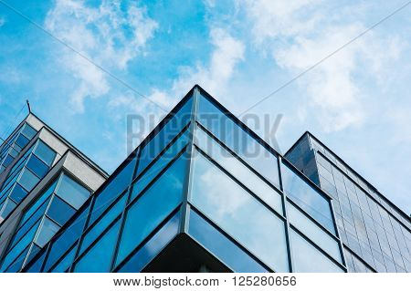 Panoramic wide angle view to steel blue background of glass high rise building skyscrapers in modern futuristic downtown at night Business concept of successful industrial architecture.