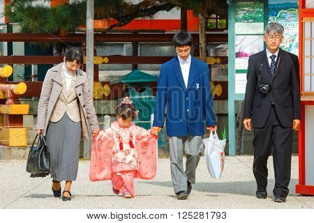 KYOTO JAPAN - NOVEMBER 22 2015: Shichi-go-san a traditional rite of passage and festival day in Japan for 3 and 7-year-old girls and 3 and 5-year-old boys at Heian-jingu Shrine