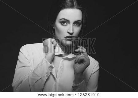 Sensual hot woman bite tux at night black and white