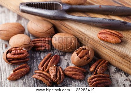 Pecan nuts on a wooden table