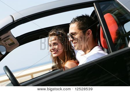 Portrait of a smiling couple in a car