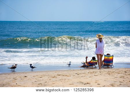 SPRING LAKE NEW JERSEY-AUGUST 1 - People enjoying a beautiful day on the beach on August 1 2015 in Spring Lake New Jersey.