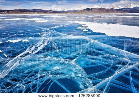 Beautiful ice in cracks . Its windy. Focus on foreground . Lake Hovsgol . Mongolia