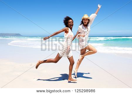 Young Friends Laughing And Running On The Beach