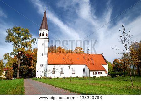 White christian church with a red roof in Sigulda, Latvia