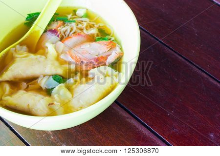 Chinese food Wonton for traditonal gourmet dumpling image on wooden background.