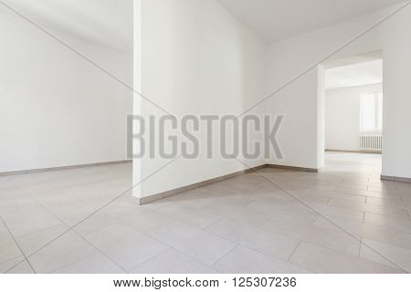 renovated old house, empty rooms with withe walls, interior