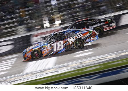 Ft. Worth, TX - Apr 08, 2016: Kyle Busch (18) and Jeremy Clements (51) battle for position during the O'Reilly Auto Parts 300 at the Texas Motor Speedway in Ft. Worth, TX.