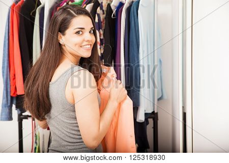 Cute Young Woman Getting Dressed