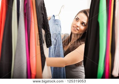 Cute Woman Looking At Her Closet