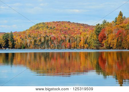 Lake with Autumn foliage and mountains with reflection in New England Stowe