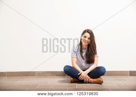 Pretty Latin Woman Sitting On The Floor