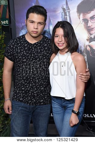 LOS ANGELES - APR 05:  Angela Aguilar & Leonardo Aguilar arrives to the Wizarding World of Harry Potter Opening  on April 05, 2016 in Hollywood, CA.
