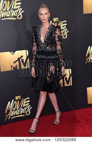 LOS ANGELES - APR 09:  Charlize Theron arrives to the Mtv Movie Awards 2016  on April 09, 2016 in Hollywood, CA.