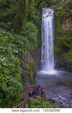 LA PAZ COSTA RICA - MARCH 22 : Waterfall at a tropical rainforest in La Paz Waterfall Gardens Costa Rica on March 22 2016. La Paz Waterfall Gardens is the Most Visited Privately Owned Ecological Attraction in Costa Rica