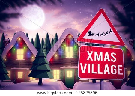 Christmas road sign against quaint town with bright moon