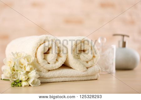 Towels and bath accessories on table