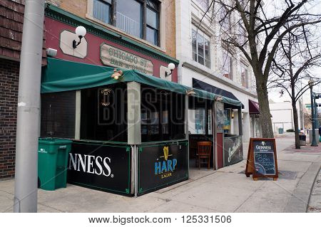 JOLIET, ILLINOIS / UNITED STATES - APRIL 12, 2015: One may drink beer at the Chicago Street Bar & Grill in downtown Joliet.