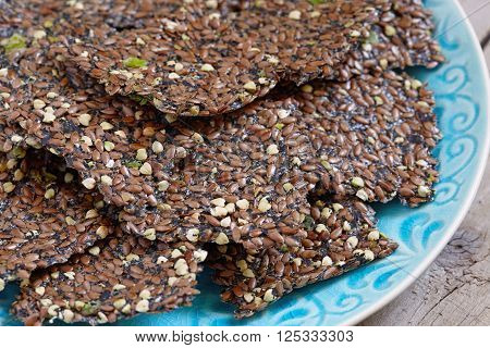 Raw flaxseed crackers with seaweed, green buckwheat and spring onion