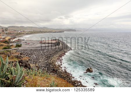 Azores seascape of city and Atlantic Ocean shore