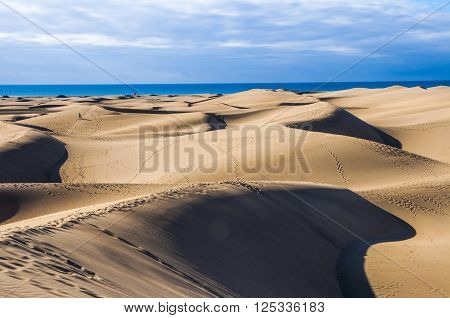 View on sunny Maspalomas dunes in Gran Canaria in daytime. Cloudy sky on background. ** Note: Visible grain at 100%, best at smaller sizes