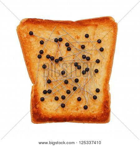 black pins on toasted bread. poaching of black caviar. smuggling, problems with the law. concept. isolated on white background