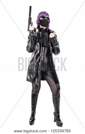 Sexy masked woman holding gun, isolated on white background.
