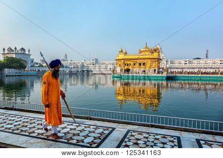 AMRITSAR, INDIA - AUGUST 26, 2011: Sikh guard in Golden Temple Sri Harmandir Sahib Gurdwara in Amritsar, Punjab, India.  Golden Temple is the holiest Gurdwara of Sikhism