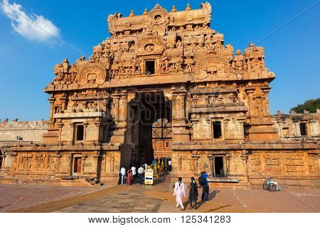 TANJORE, INDIA - MARCH 26, 2011: People visiting famous Brihadishwarar Temple in Tanjore (Thanjavur), Tamil Nadu, India.  It is UNESCO World Heritage Site and importang religious and cultural site