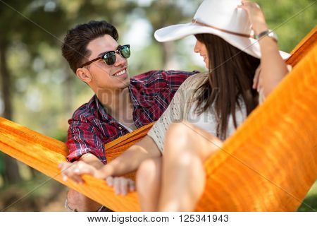 Close up of loving couple in orange hammock outdoor