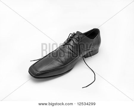 Male Black Leather Shoe Against White