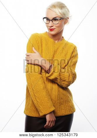 Young blond woman wearing yellow sweater