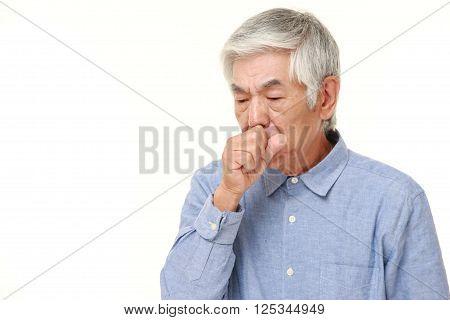 senior Japanese man coughing on white background