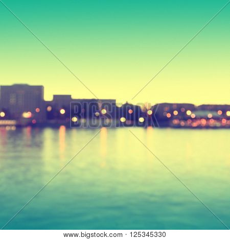 Abstract blurred cityscape background with bokeh effect. Vintage style.