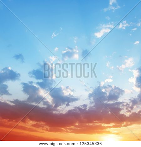 Blue sky with clouds at sunset.
