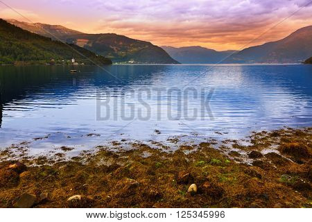 Sunset in fjord Hardanger Norway - nature and travel background