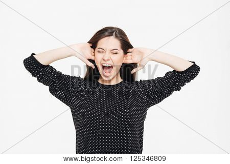 Beautiful woman screaming isolated on a white background