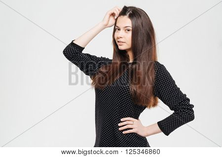 Beautiful casual woman looking at camera isolated on a white background