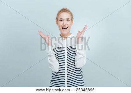 Cheerful woman with mouth open looking at camera isolated on a white background