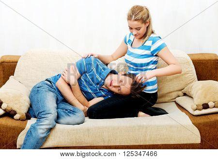 Woman comforting her sad husband