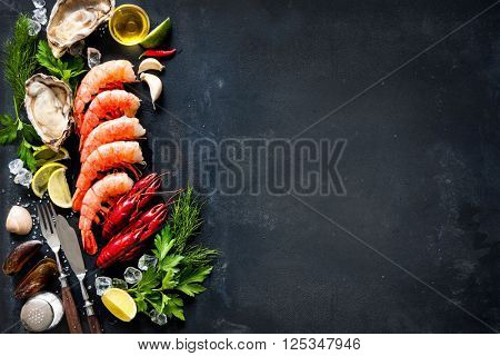 Shellfish plate of crustacean seafood with shrimps, mussels, oysters as an ocean gourmet dinner background